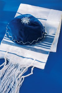 "The word ""tallit"" means literally, ""little tent."""
