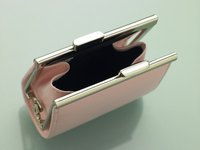 Coin purses often feature metal-hinged clasps, which give them strength and keep your change contained.