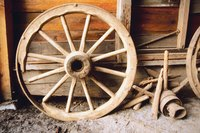 Create an exact miniature replica of this wagon wheel.