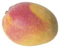 Alphonso mangoes have a red and yellow skin similar to the one pictured.