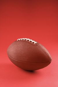 An old football works well as a prop for a girl's football costume.