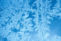 Preserve nature's artwork by tracing window frost with white, washable paint.