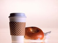 Replace that boring cardboard with a colorful, reusable coffee sleeve
