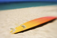 Make a doll-sized surfboard using craft supplies.