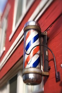 Paint the colored lines on a barber pole.