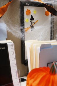 Decorate your home or office with faux spider webs for Halloween.
