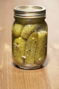 Pack pickles uniformly and leave space for brine.