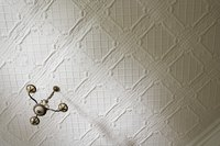 Install textured ceiling panels to hide flaws.