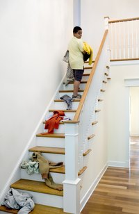 A closet's door at the top of stairs must have adequate clearance.