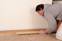 Caulk the gap between the edge of the flooring and trim.