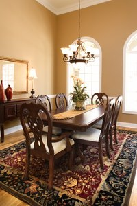 Traditional furnishings and lush carpeting give the dining room a formal air.