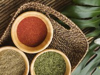 A basket of spices on a palm leaf.