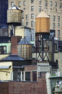Unlike pressure tanks, municipal water tanks provide water pressure through gravity.