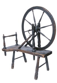 In the olden days, yarn was made at home on spinning wheels.