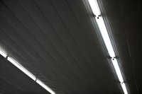 Fluorescent lighting in a garage may sometimes be slow to come on.