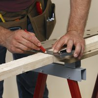 Using 2x4 inch boards will allow you to frame your basement poles.