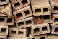 Cinder blocks have hollow cells and solid webbing.