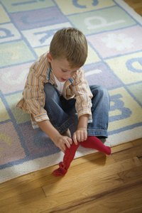 Boys will enjoy personalizing basic socks with paint and embellishments.