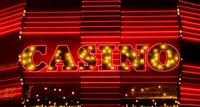 Paint a garish casino sign for your front door.