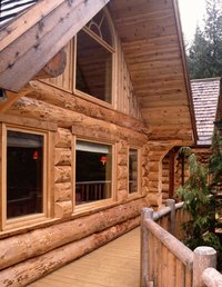 Log homes need periodic restaining, just like any outdoor wood.