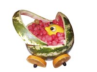 Use a lemon as the baby in your watermelon baby carriage.