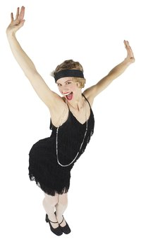 Turn a plain black dress around to look like a flapper.