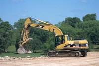A backhoe digs quickly and accurately.