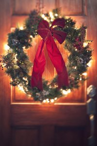 Attach the bow to the wreath with a dab of hot glue or a piece of wire.