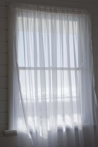 Sheer curtains should be about three times the window width.
