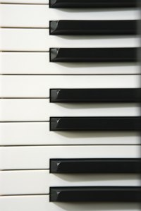 Clean piano keys as soon as you notice marker stains.