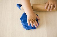 Add a few drops of food coloring to produce blue clay.