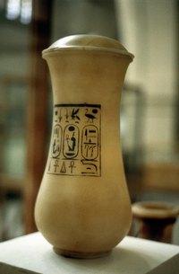 Create handmade canopic jars using basic craft supplies.