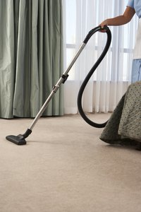 New carpets can produce fuzz, which must be removed.