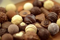 A close-up of decadent chocolate pralines.