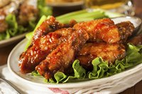 Serve hot chicken wings with cold vegetables to provide a contrast for your palate.