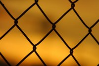 Roll up a chain link fence before disposing it.