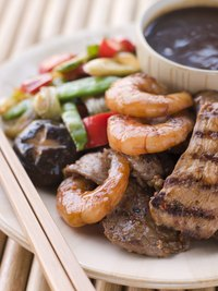 Colorful vegetables, tender meat and tang dipping sauce liven up teppanyaki platters.