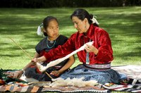 Navajo Indians make woolen rugs by hand after spinning the yarn and dyeing it.