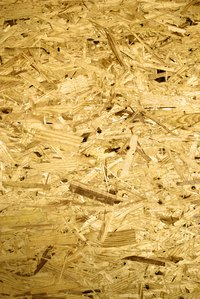 Chipboard is preferable to plywood for shelving, as it is resistant to bowing.