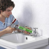 Creating a waterproof seal around sink components can fight bacteria growth.