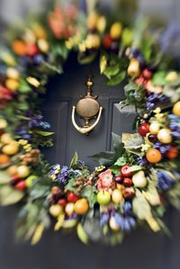 Don't cover a peep hole or door knocker with the wreath.