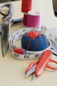You can embroider simple designs on a hat by hand, so no expensive machinery is required.