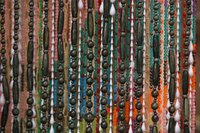 String beads to make a beaded curtain for your doorway.