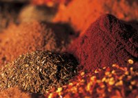 Smoky spice blends can mimic smoked pork in recipes.