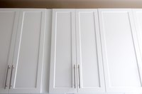 Dress up flat cabinets wtih paint, trim and hardware.