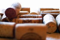 Glue wine corks together for a craft project.