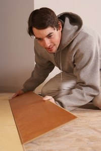 Installing laminate flooring gives you a wood look-alike surface.