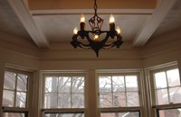 Chandeliers that appear small from ground level can actually be large, heavy fixtures.