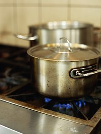Use your stove to heat the water.