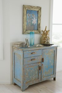 Combine a darker basecoat with a lighter topcoat to antique a dresser.
